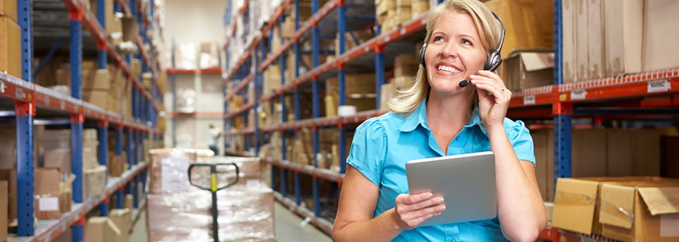 03-2018_960x_Lady-w-tablet-in-isle-of-warehouse.jpg